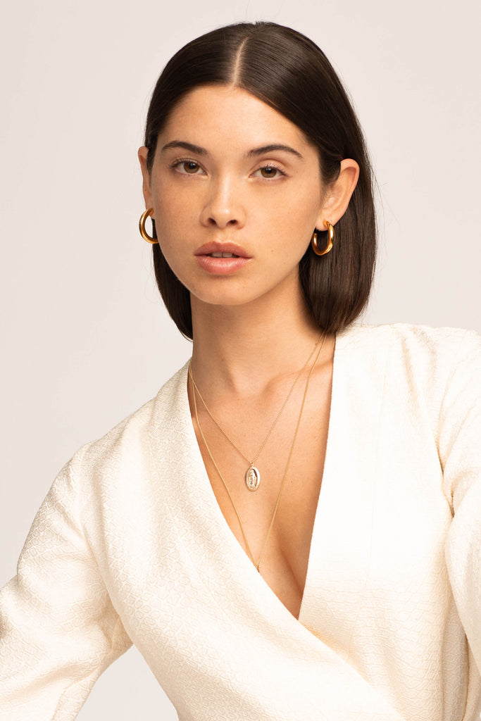 Model wearing Mini Gold Hollow Hoops Earrings Bagatiba