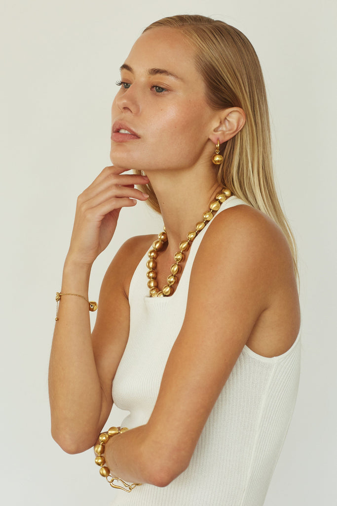 Profile view of model wearing Mixed Sphere Necklace Necklace bagatiba