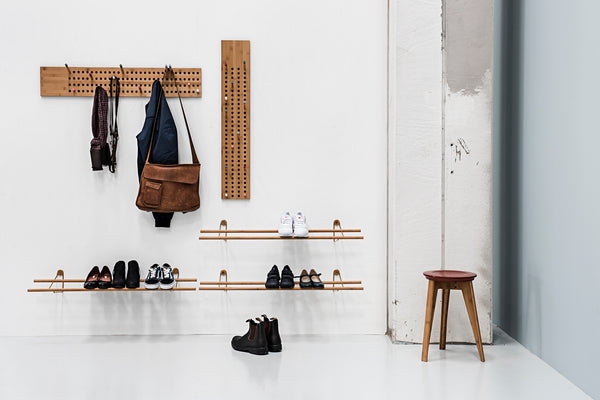 lifestyle shot of we do wood scoreboards, shoe rack and button stool with industrial styling.  Modern, minimal designs, sustainably made in bamboo.