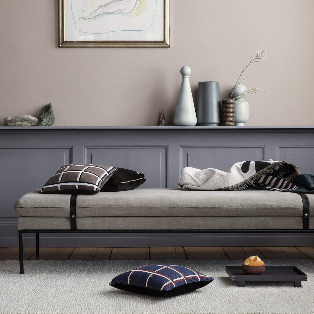 turn daybed in cotton linen, natural by ferm living, black leather straps in Scandinavian interior