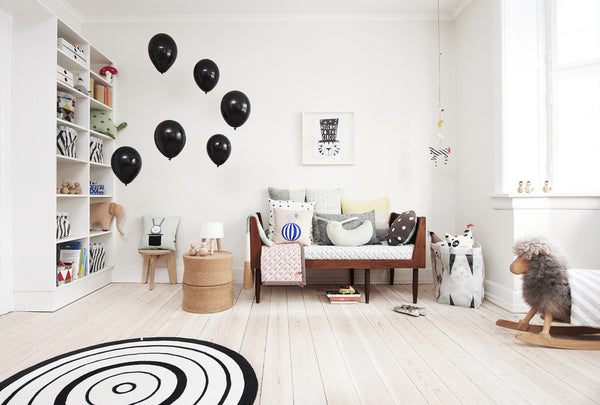Scandinavian inspired nursery with stylish furniture and home accessories.  A neutral colour scheme with monochrome accents creates a design-led environment inspiring creative play.