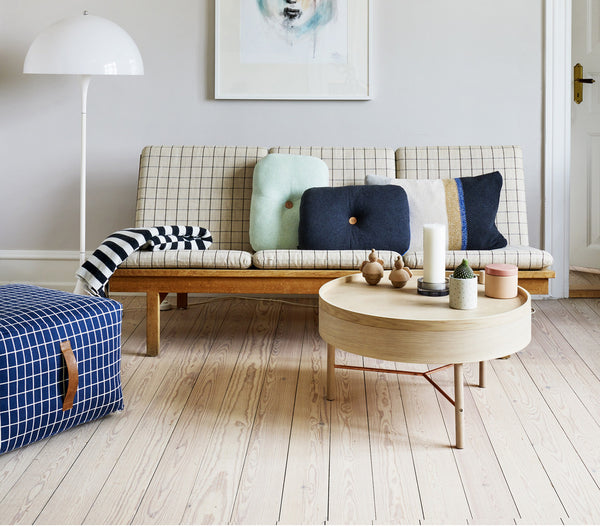 the sit on me pouf square sits centre stage in this Scandinavian styled living room.