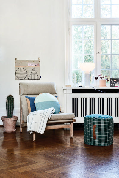 the sit on me pouf cylinder sits centre stage in this Scandinavian styled living room.