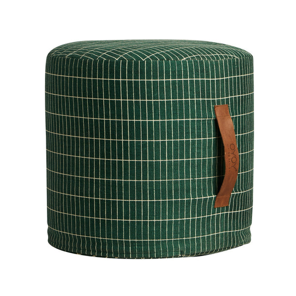 sit on me pouf cylinder by OYOY with its grid monochrome pattern and leather handle offers a stylish additional seating solution