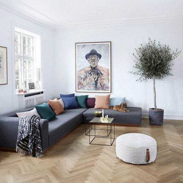the sit on me pouf round sits centre stage in this Scandinavian styled living room.
