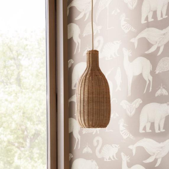 ferm living hand braided rattan bottle lamp shade in a child's bedroom. Available from someday designs