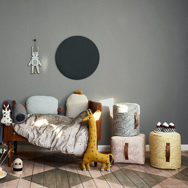 The mini paddy pouf series by OYOY add a modern style to this Scandinavian inspired children's room.