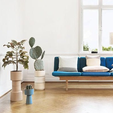 neutral living room setting with stack of kana pots by oyoy living