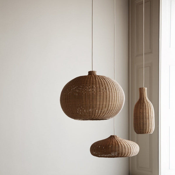 ferm living handed braided rattan lampshades hung in a living room. Available from someday designs