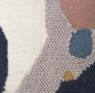 detail of loop cushion landscape by ferm living