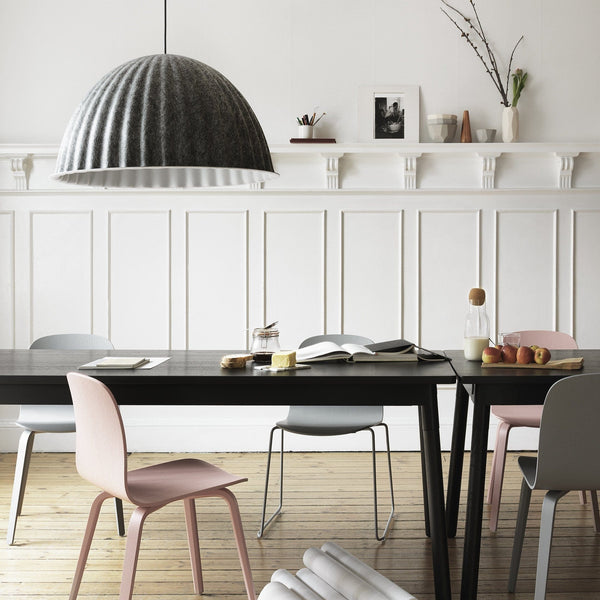 muuto under the bell pendant lamp grey hung over dining table