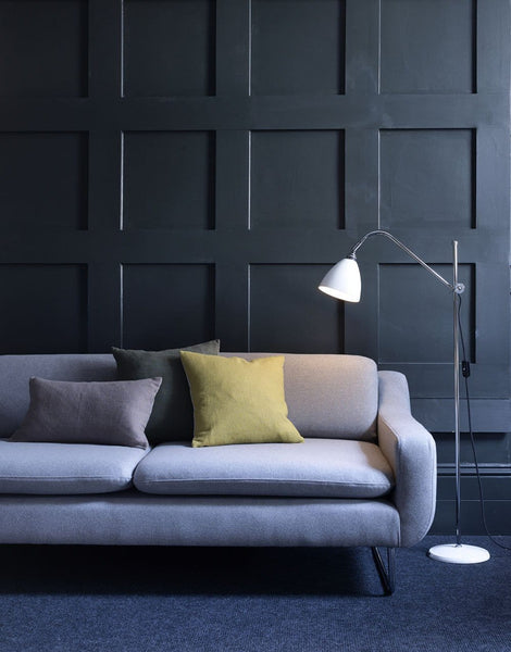 Aspen 3 seater sofa in lifestyle shot with minimal, moody styling