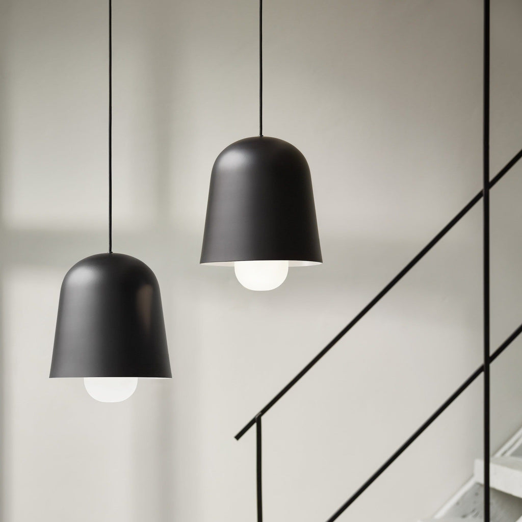 puik cone pendant in black, displayed as a cluster in a hallway setting. Available to buy at someday designs