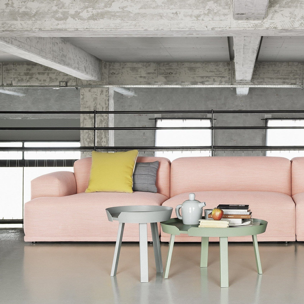 muuto lifestyle connect sofa, around coffee tables small and large in grey and dusty green