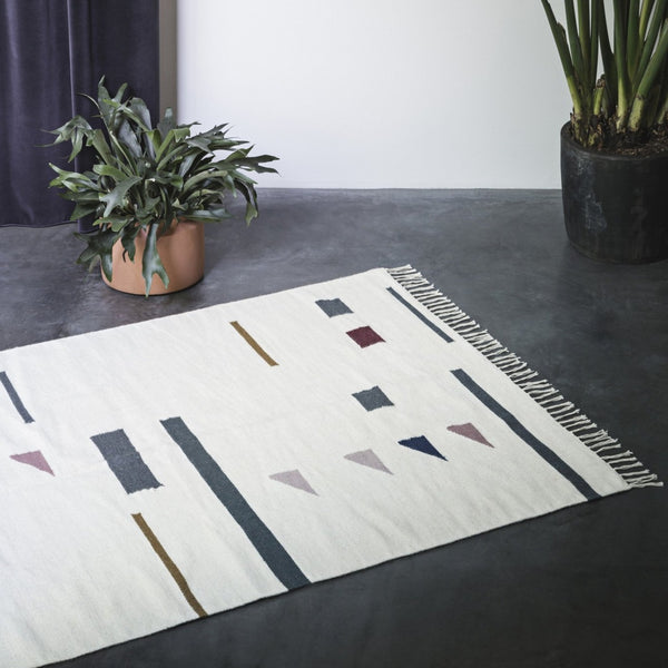 lifestyle shot of kelim rug colour triangles from Ferm Living