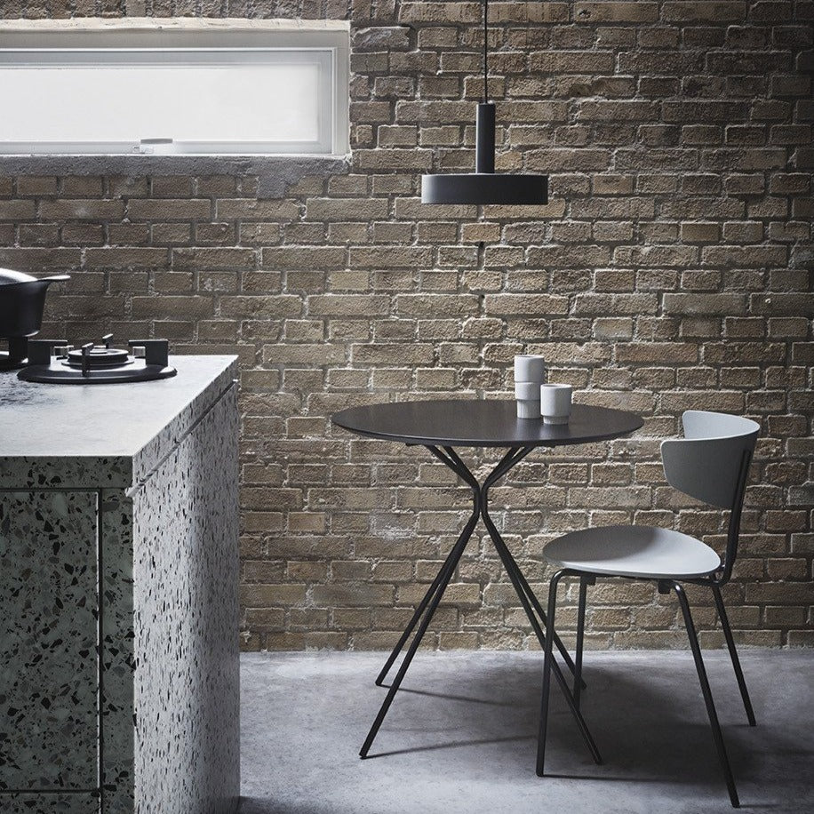 industrial and minimal dining scene with brick wall back drop to Ferm Living's collect lighting series and herman dining collection.
