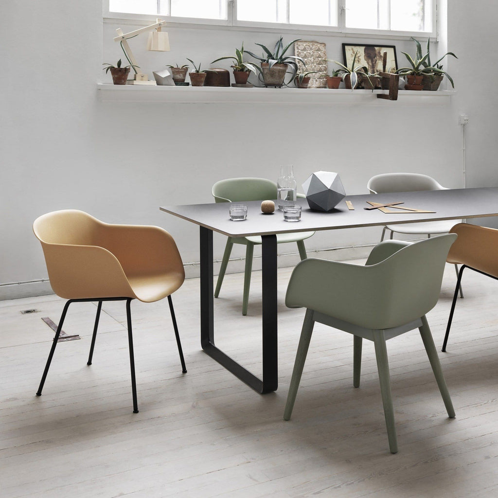 Muuto Fiber Armchair with wood base in a dining room setting. Available from someday designs.