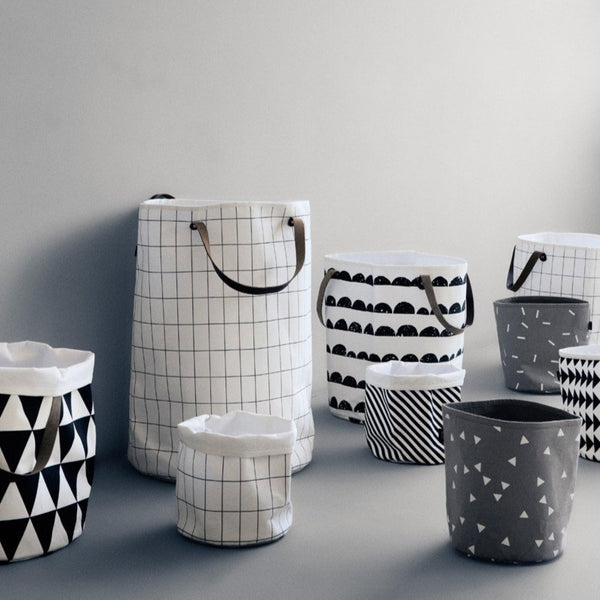 lifestyle shot of baskets and laundry baskets by Ferm Living.