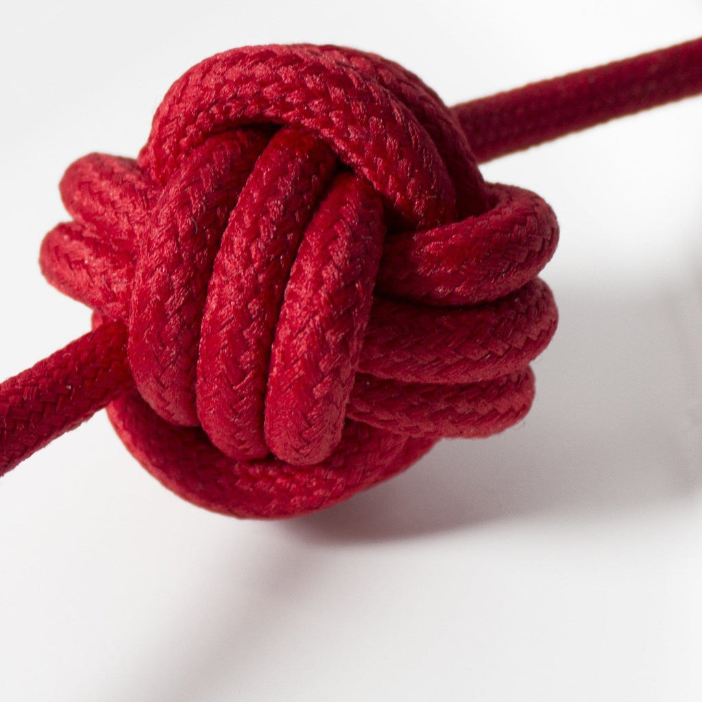 Detailed, close up shot of red fabric cable used on small knot lamp by Vitamin