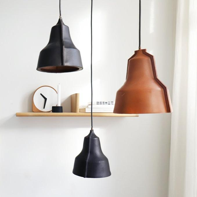 puik lloyd leather pendant in a cluster of black and natural, available from someday designs