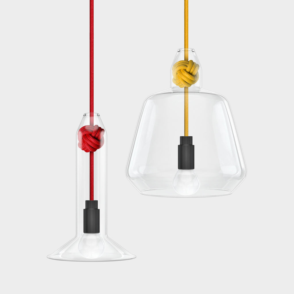 Knot Lamp is made from handblown glass with two shade designs, both supported by a monkey fist knot in a choice of 6 colours.  Pictured here with small shade with red fabric cord and large shade with yellow fabric cord.  Beautiful, simple and versatile lighting.