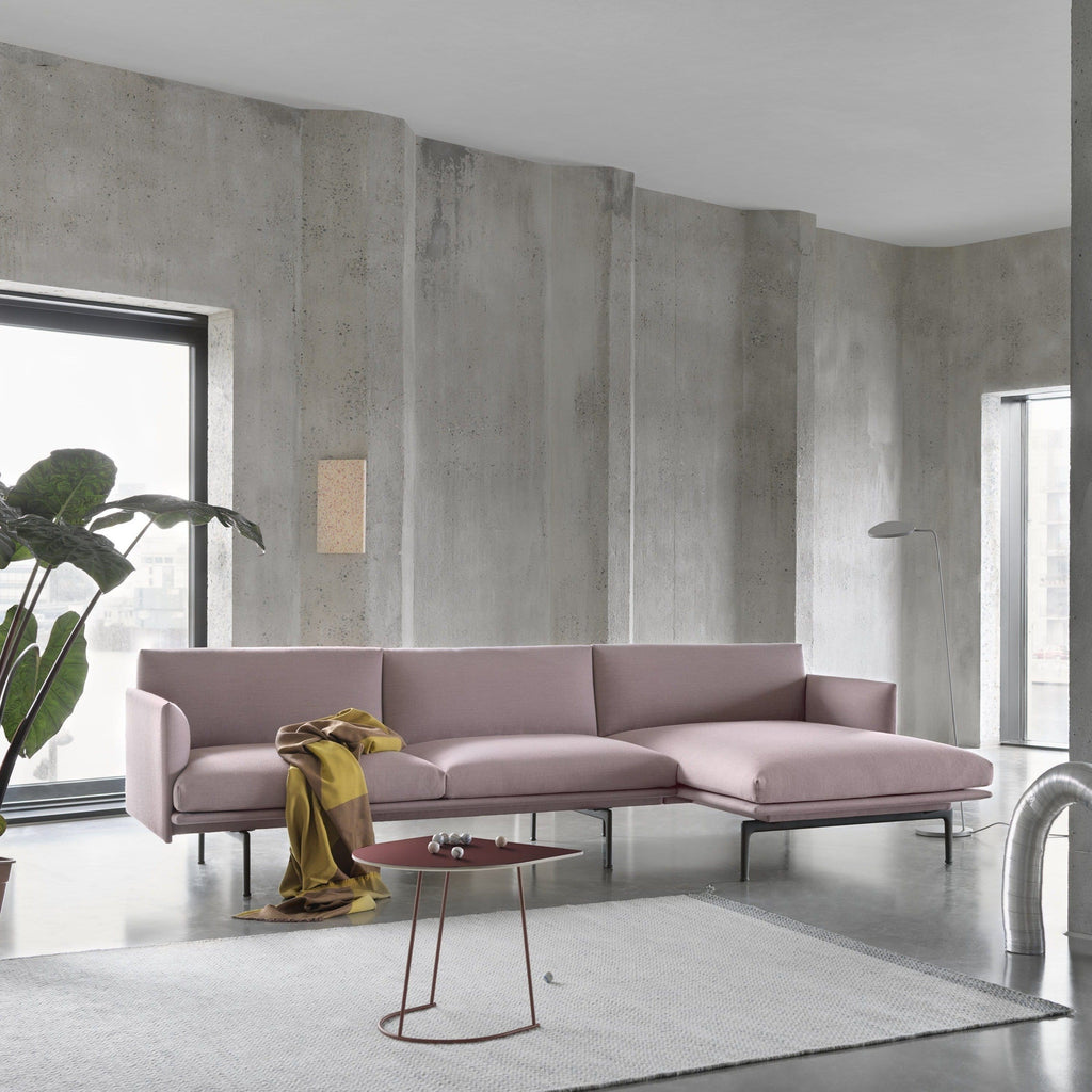 outline sofa chaise longue by muuto in industrial setting with airy side table
