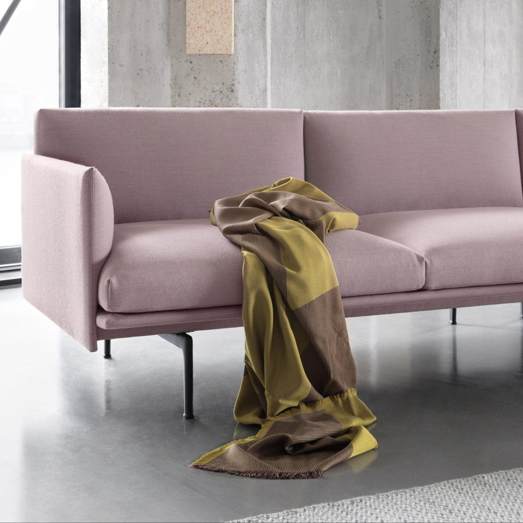 outline sofa chaise longue by muuto in industrial setting