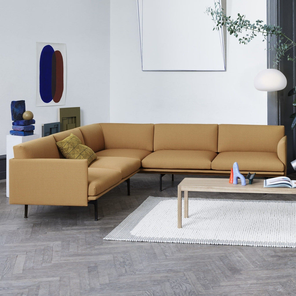 Muuto Outline Corner Sofa in cognac refine leather in a living room setting. Available made to order from someday designs