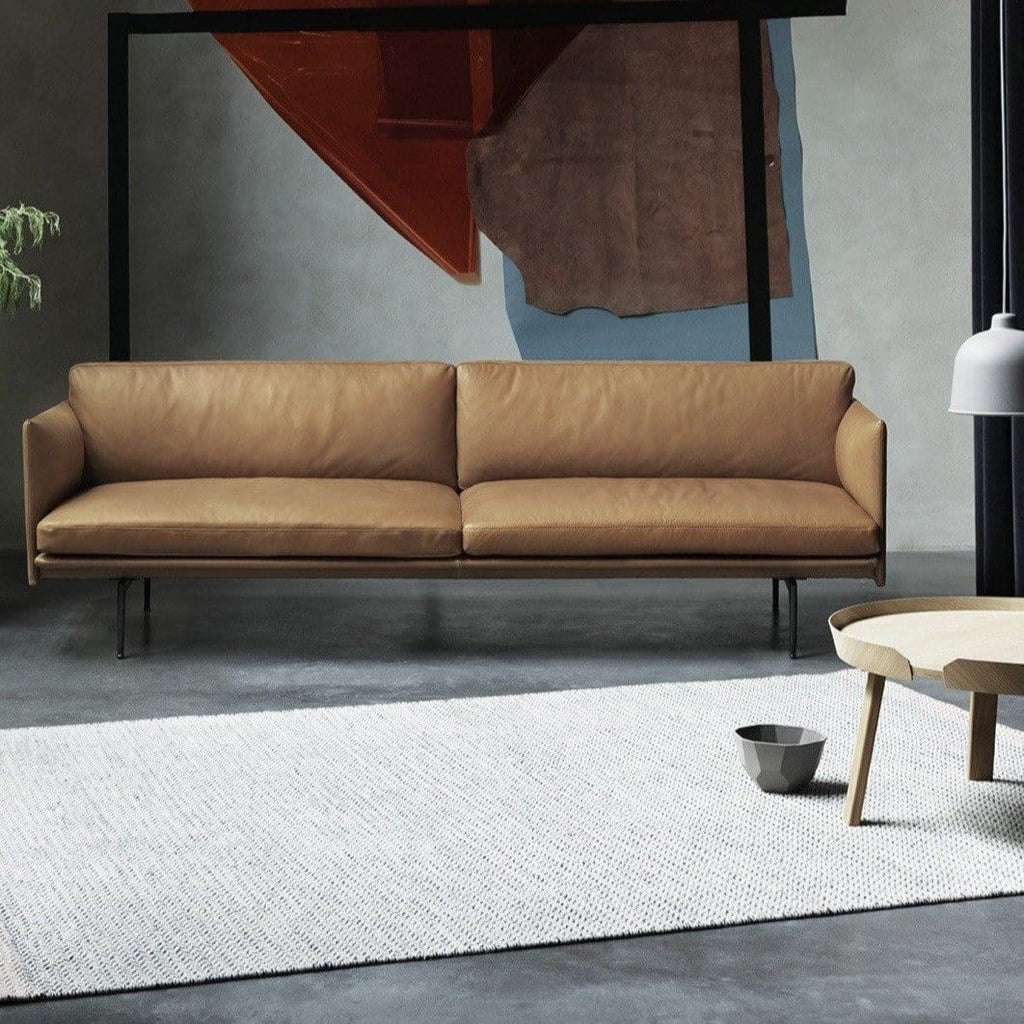 muuto outline sofa cognac silk leather in lifestyle industrial setting