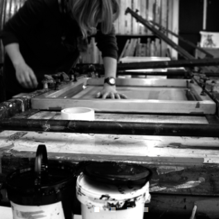 behind the scenes shot of Jo Ham screen printing her HAM series of playful prints.