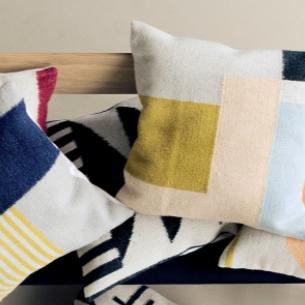 Bundle of cushions by Ferm Living including Kelim black lines, triangles and squares.