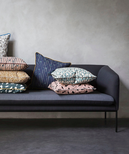 Lifestyle shot of the fashion cushion bundles by Ferm Living