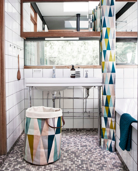 spear laundry basket by Ferm Living in a modern and bright bathroom