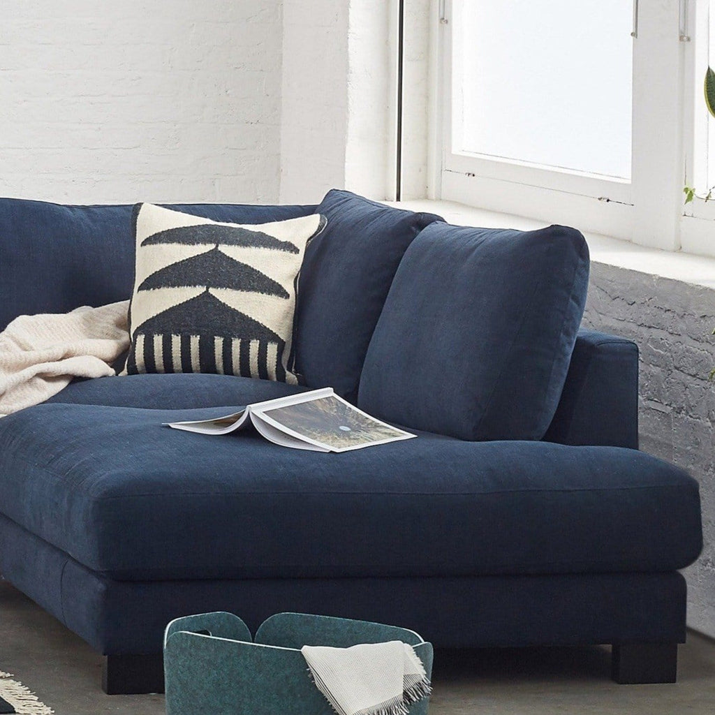 toft corner in pure 01 navy with black legs in lifestyle setting