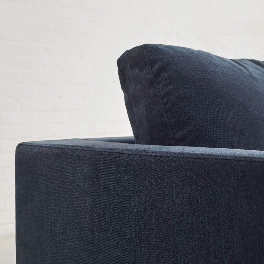 toft 3 seater in pure 01 navy close up lifestyle of arm and back cushion