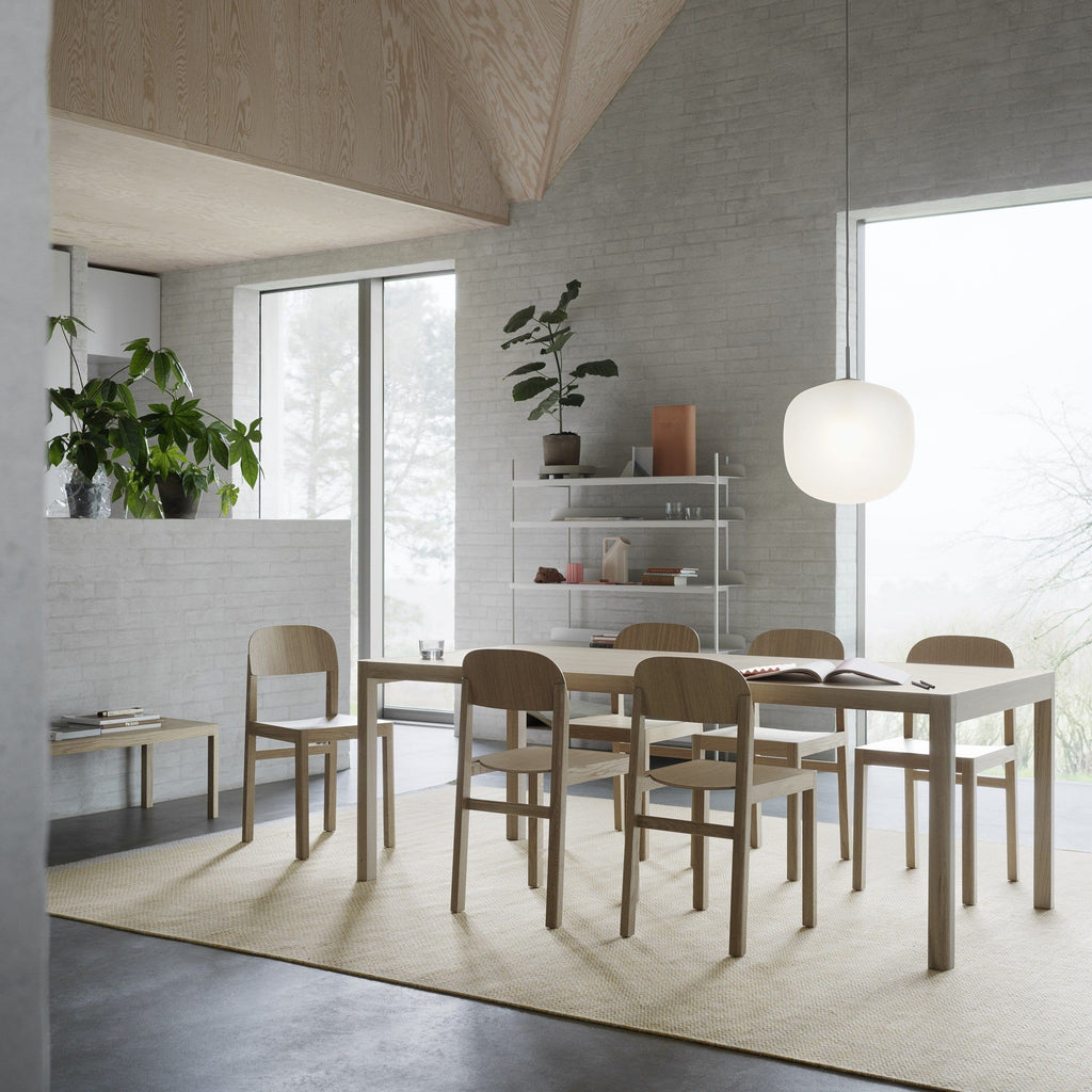 Muuto Workshop Table 200x92 in warm grey linoleum and oak in a dining room setting. Shop online at someday designs.