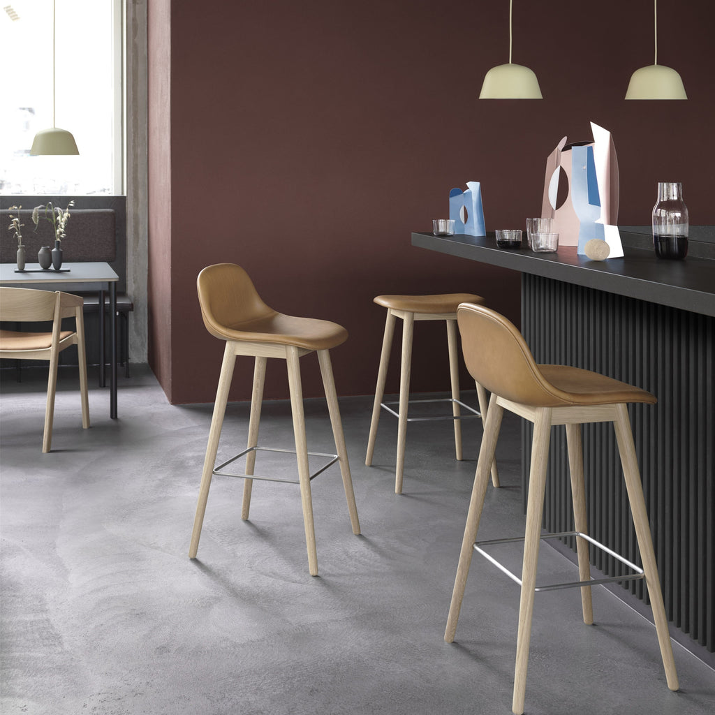 lifestyle of fiber bar stools wood base by muuto