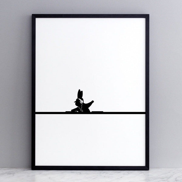 black and white image of HAM rabbit mixing records.  Fun and playful series of prints.  Ideal for adults and children. Pictured here on marble surface with grey painted wall backdrop.