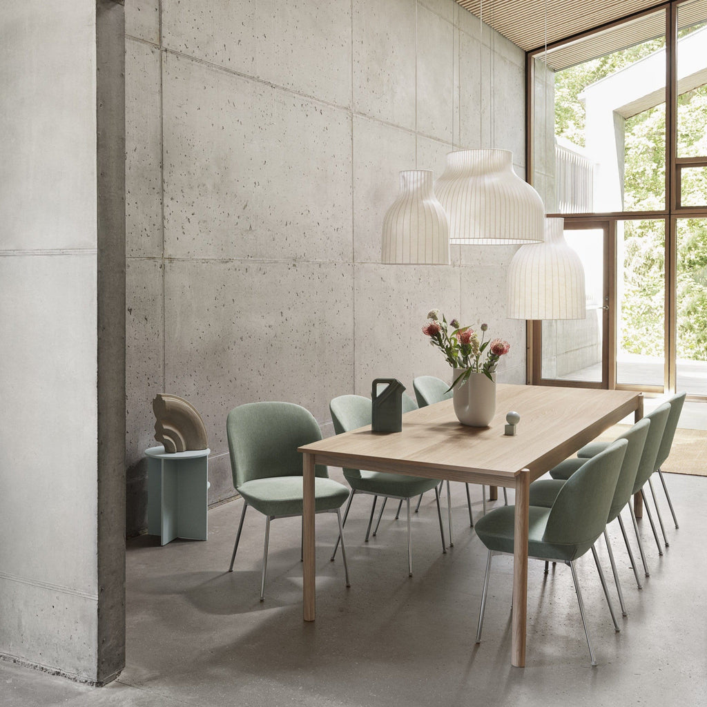 Muuto  Strand Pendant Ceiling Lamp open in a cluster over a dining table. Available from someday designs
