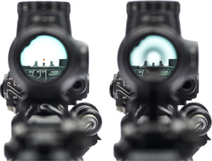 The view through the red dot sight of an AR 15 rifle that shows the LEAF metal front sight attached on top of a laser sight module.
