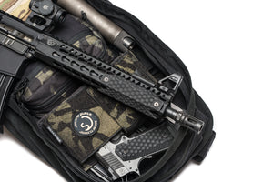 Rifle handguard with honeycomb textured rail covers.