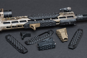 A variety of honeycomb textured rail covers and hand grips for AR15 handguards.