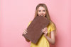 Girl eating giant chocolate bar