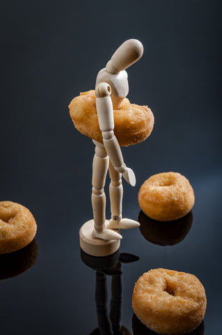 obese man with donuts