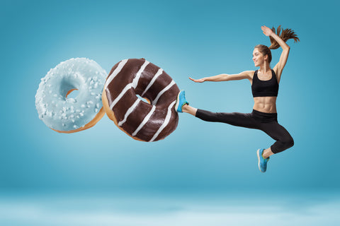 Girl kicking donuts