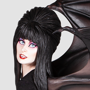 Close-up of Elvira's face on the Grand Jester Statue
