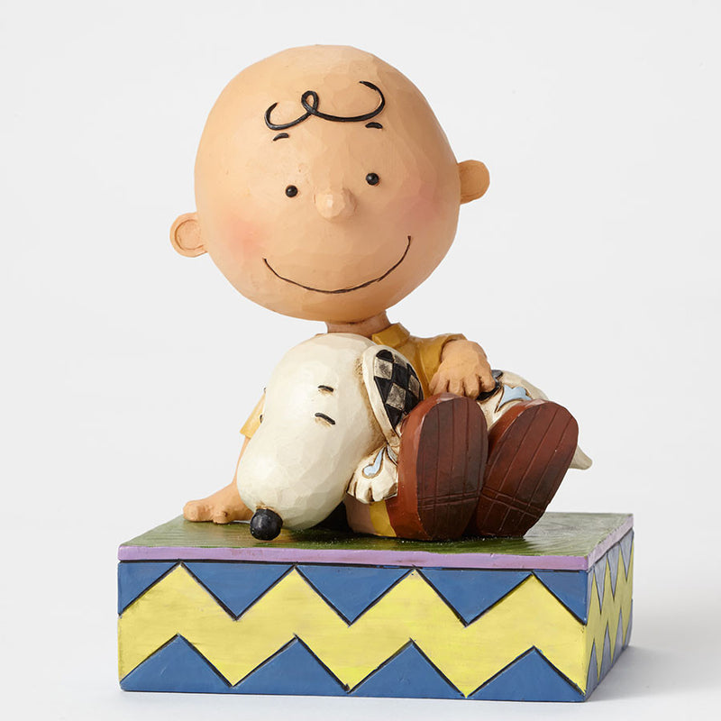 Charlie Brown Holding Snoopy