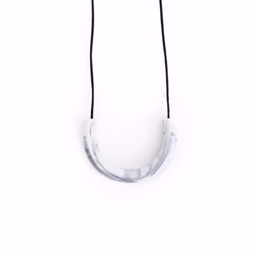 Boo Chew Arc shaped Teething Necklace in marble grey. Teething necklace worn by mums