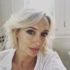 Ali Bastian wearing our gold filled infinity stud earrings