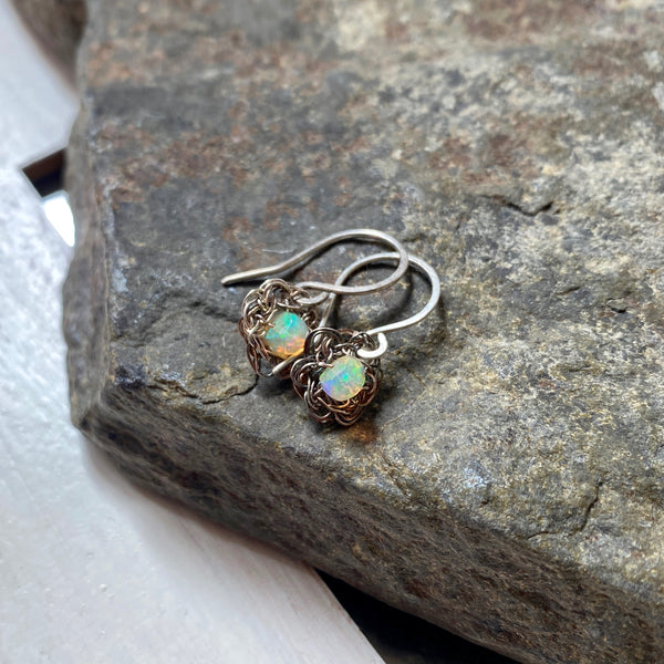opal earrings on silver lace